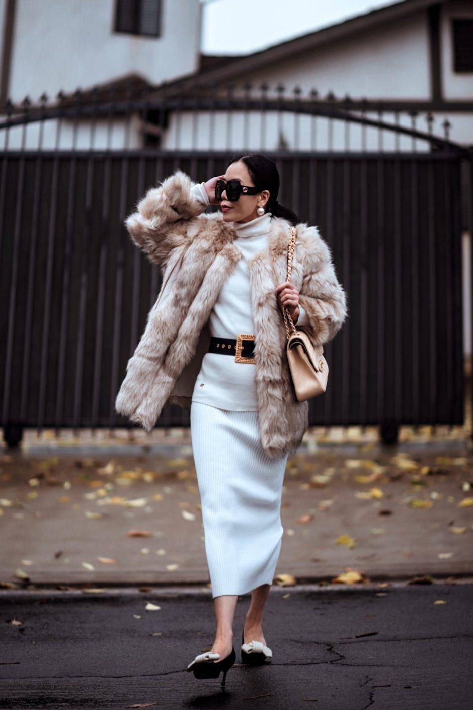 hallie daily blogger coat sweater skirt belt bag shoes sunglasses jewels winter outfits faux fur jacket chanel bag knitted skirt dress knitted dress turtleneck dress belted dress midi dress pumps faux fur coat black belt midi skirt white skirt turtleneck sweater white sweater knit shoulder bag