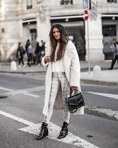 pants,snake print pants,ankle boots,lace up boots,white sweater,white coat,long coat,black bag,patent shoes