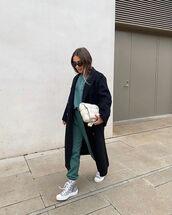 bag,white bag,sneakers,joggers,black coat,sweatshirt