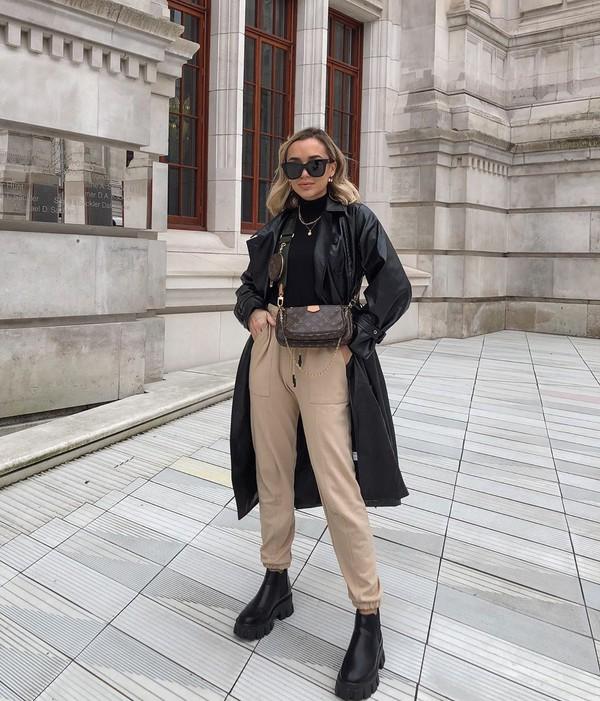 coat black coat leather black boots cargo pants black turtleneck top crossbody bag