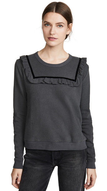 THE GREAT. THE GREAT. The Velvet Bib Sweatshirt in black