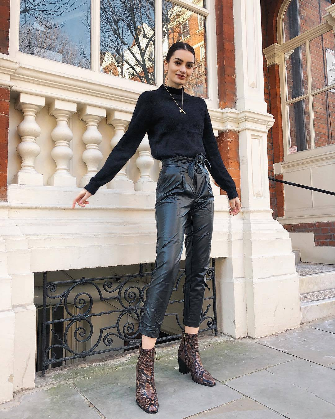 pants black vinyl pants high waisted pants ankle boots brown boots snake print black sweater