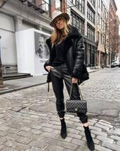 pants,black leather pants,cropped pants,black boots,heel boots,black bag,chanel bag,aviator jacket,black sweater,hat