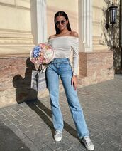 top,white top,off the shoulder,straight jeans,sneakers,bag