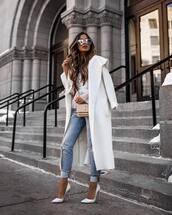 coat,white coat,long coat,white shoes,pumps,skinny jeans,ripped jeans,ysl bag,white sweater,cable knit