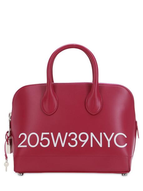 CALVIN KLEIN 205W39NYC Small Dalton Logo Printed Leather Bag in fuchsia