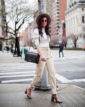 pants,cargo pants,high waisted pants,snake print,pumps,white turtleneck top,black bag,hat