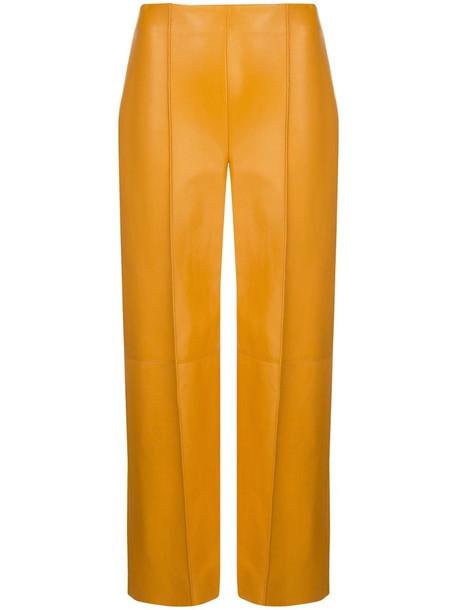 Oscar de la Renta lambskin leather cropped trousers in yellow