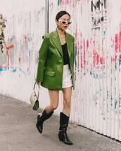 jacket,leather jacket,green jacket,cowboy boots,marni,black boots,shoulder bag,white shorts,black top,white sunglasses