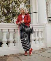pants,striped pants,wide-leg pants,high waisted pants,black and white,platform sandals,red jacket,biker jacket,black bag,white t-shirt