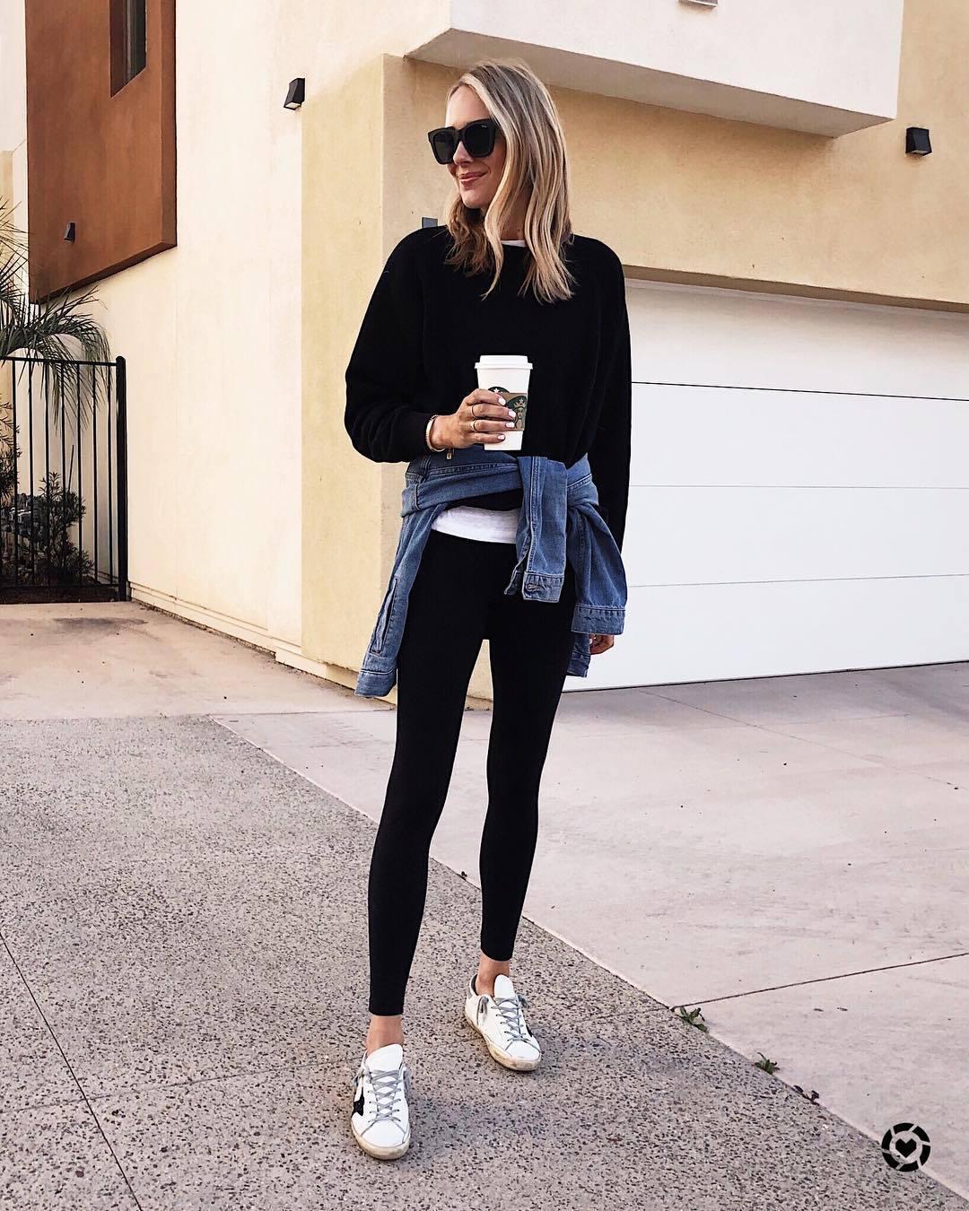 top sweatshirt white sneakers black leggings denim jacket sportswear sunglasses white t-shirt