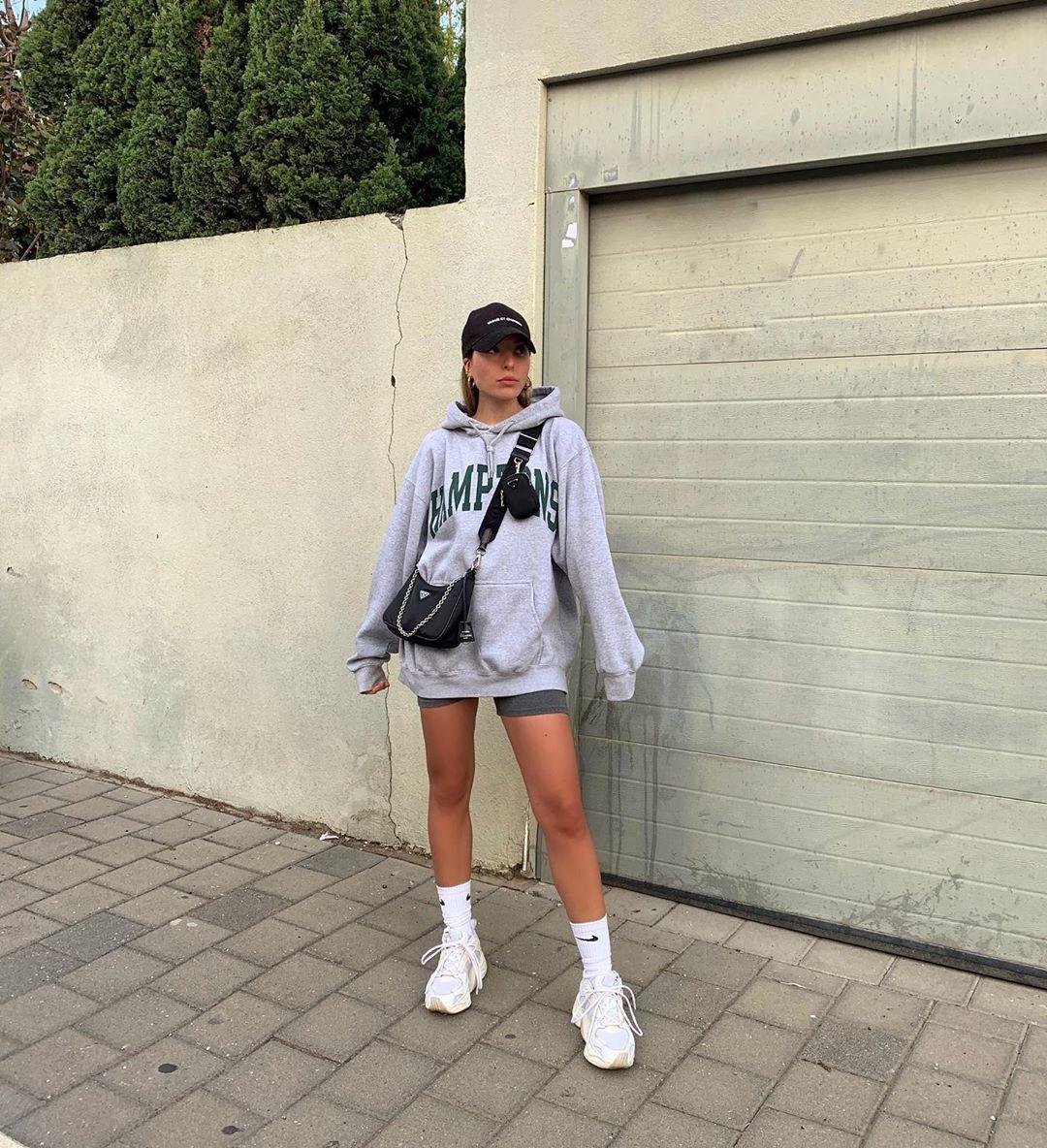 sweater hoodie prada bag white sneakers shorts cap