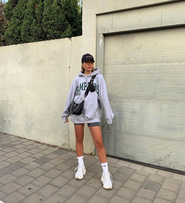 sweater hoodie prada bag white sneakers shorts cap