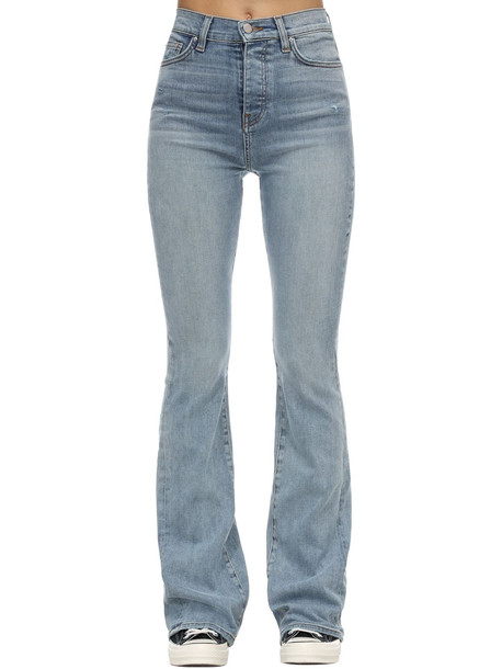 AMIRI Flared Stretch Denim Stack Jeans in indigo / stone