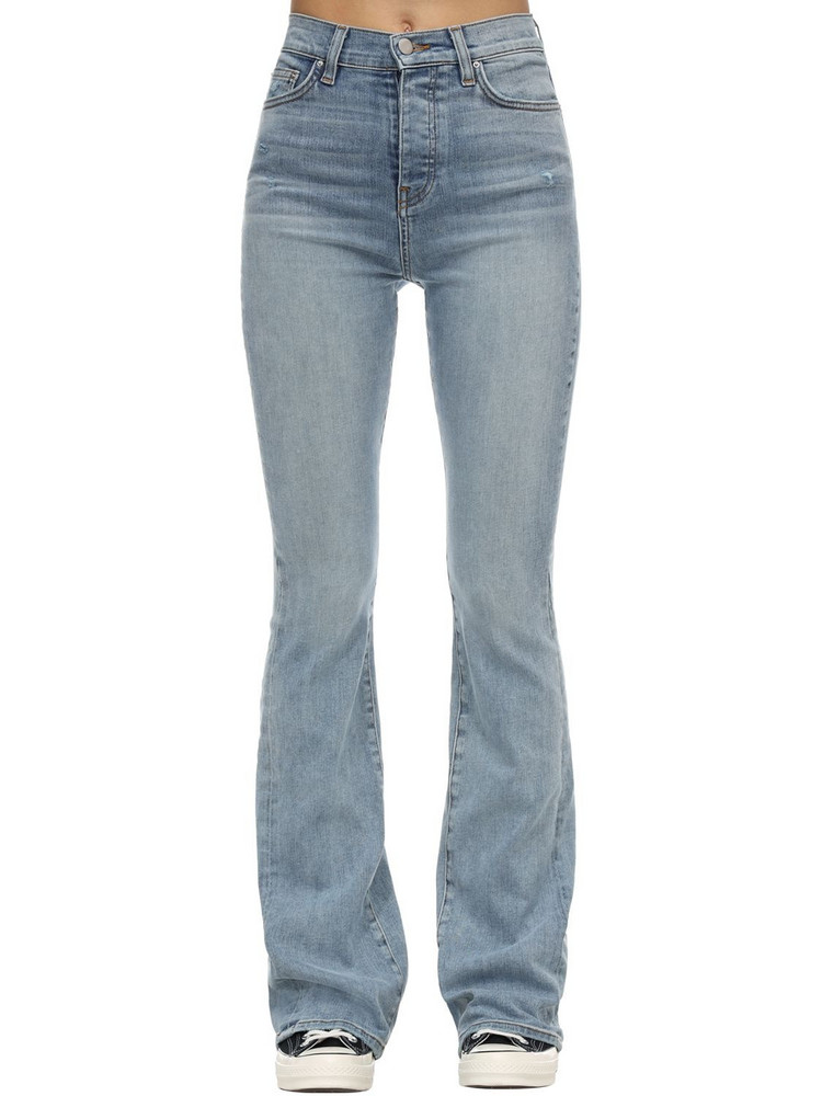 AMIRI Flared Stretch Denim Stack Jeans in indigo / stone