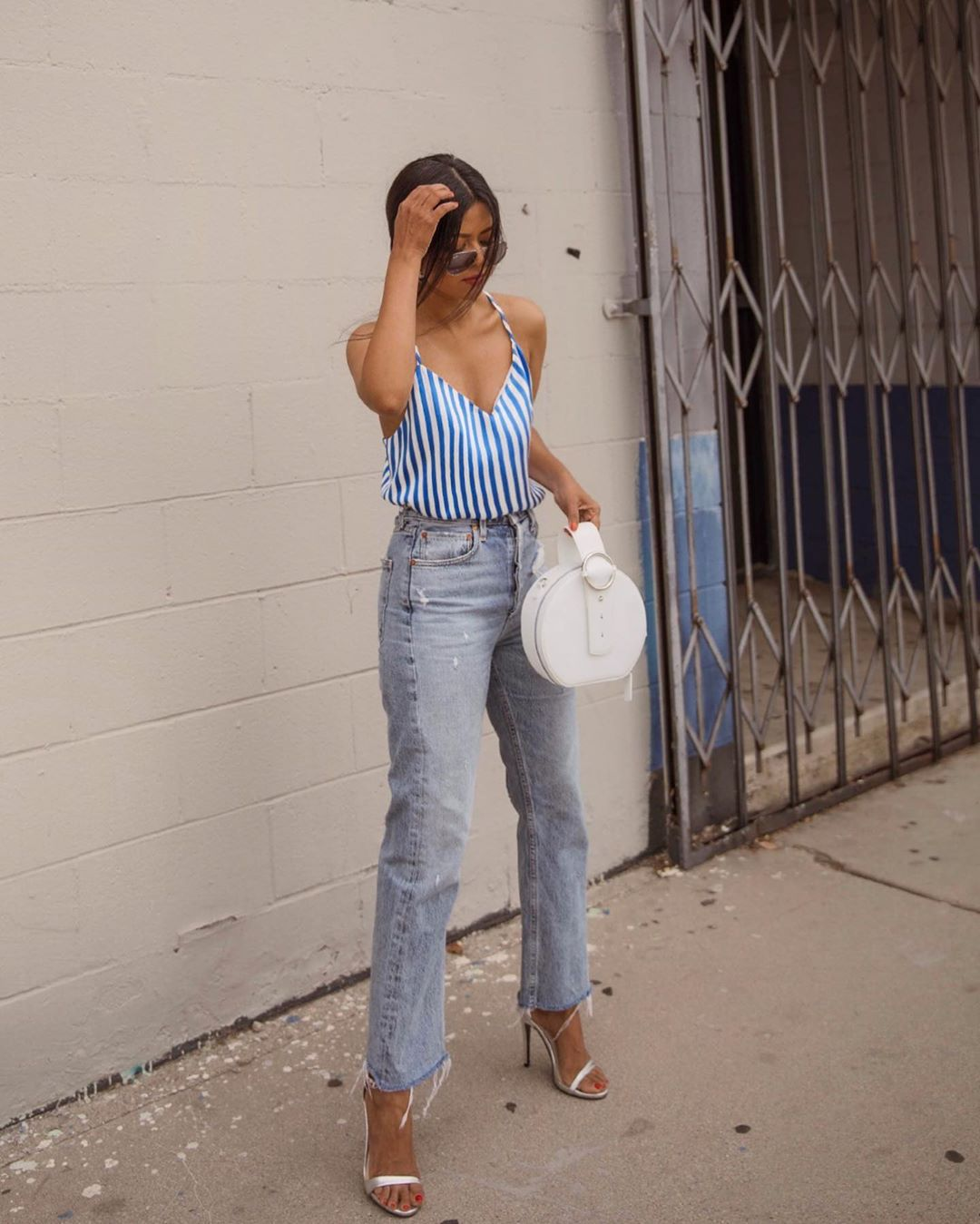 top tank top stripes high waisted jeans cropped jeans sandal heels white bag round bag