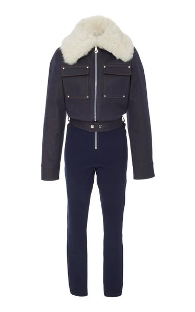 Cordova Courchevel Shearling-Trimmed Denim Jumpsuit in blue