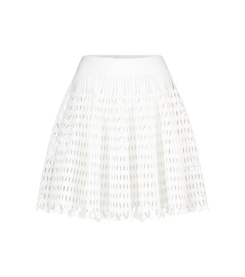 Alaïa Stretch-knit miniskirt in white