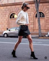 skirt,leather skirt,mini skirt,black skirt,high waisted skirt,black boots,ankle boots,heel boots,black bag,white sweater,sunglasses