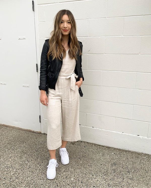 jumpsuit cropped white sneakers black leather jacket
