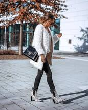 shoes,ankle boots,heel boots,snake print,black skinny jeans,black bag,shoulder bag,white coat,faux fur coat,knitted sweater