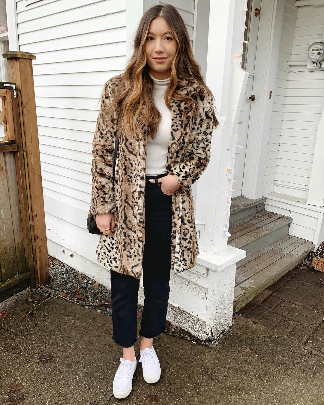 coat faux fur coat leopard print white sneakers black jeans cropped jeans straight jeans white turtleneck top black bag