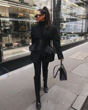 jacket,black blazer,knee high boots,black boots,black skinny jeans,black bag,black turtleneck top