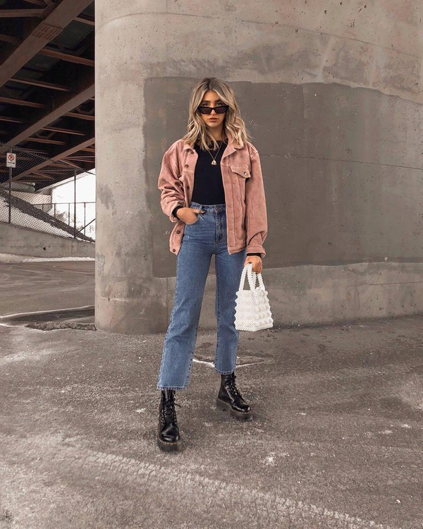 sweater pink jacket high waisted jeans straight jeans black boots DrMartens black top white bag handbag