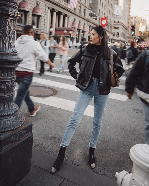 jeans high waisted jeans skinny jeans ankle boots black boots shearling jacket black top bag