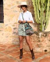 top,white shirt,mini skirt,high waisted skirt,brown boots,cowboy boots,dior bag,felt hat