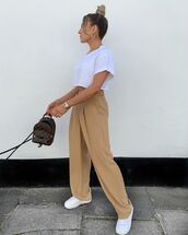 top,white t-shirt,crop tops,high waisted pants,white sneakers,louis vuitton bag