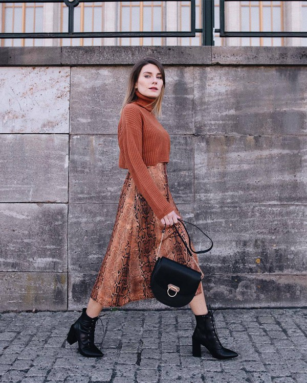 sweater turtleneck sweater cropped turtleneck snake print midi dress ankle boots black boots lace up boots black bag