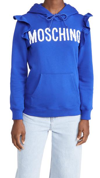 Moschino Logo Ruffle Hoodie in blue / print