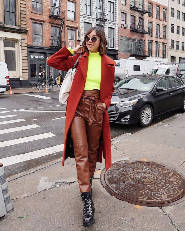 pants high waisted pants leather pants patent boots lace up boots orange coat turtleneck white bag