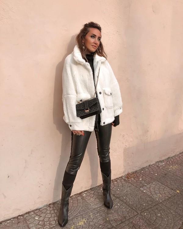 jacket teddy jacket black boots black leather pants black bag black turtleneck top