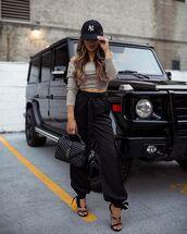 pants,black pants,black sandals,black bag,ysl bag,crop tops,off the shoulder top