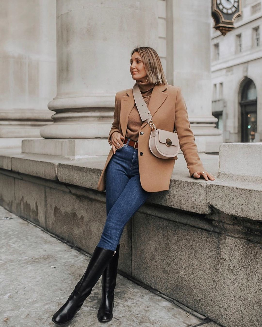 jacket blazer black boots knee high boots high waisted jeans skinny jeans turtleneck sweater crossbody bag