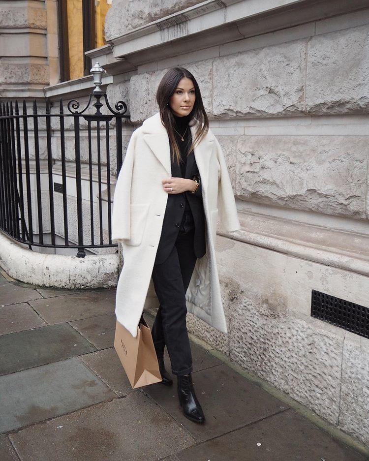 coat white coat ankle boots black boots black jeans black blazer black turtleneck top