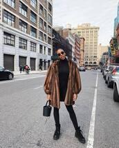 bag,bucket bag,black bag,black boots,ugg boots,black leggings,black turtleneck top,faux fur coat