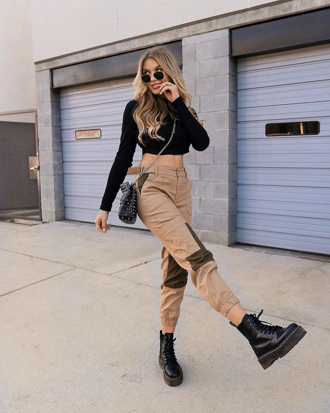 pants high waisted pants black boots ankle boots black top crop tops black bag