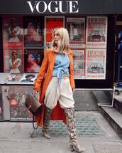 coat,orange coat,long coat,knee high boots,snake print,pleated,high waisted pants,louis vuitton bag,blue sweater