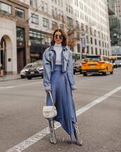 skirt,satin skirt,satin,midi skirt,high waisted skirt,asymmetrical skirt,blue skirt,snake print,heel boots,white bag,denim jacket,white turtleneck top