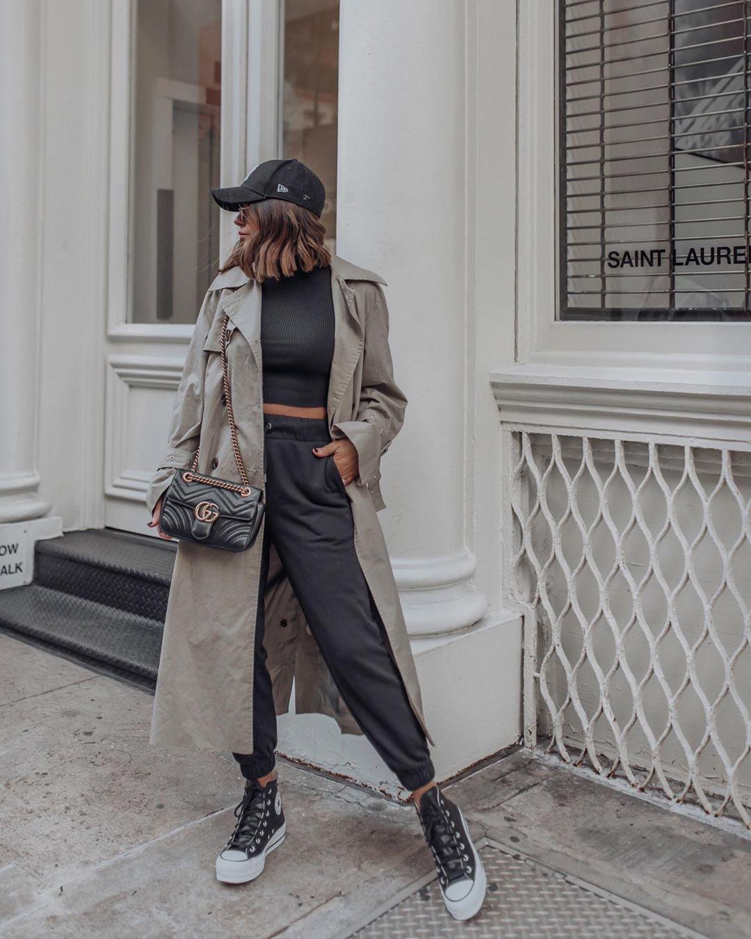 pants joggers trench coat sneakers black turtleneck top gucci bag hat