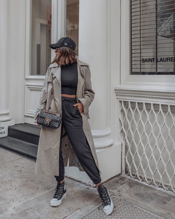 pants joggers trench coat sneakers black turtleneck top gucci bag hat
