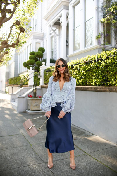 carriebradshawlied blogger skirt top shoes bag sunglasses jewels blue dress blue blouse spring dress midi skirt satin blue skirt blouse v neck puffed sleeves pumps stripes navy skirt