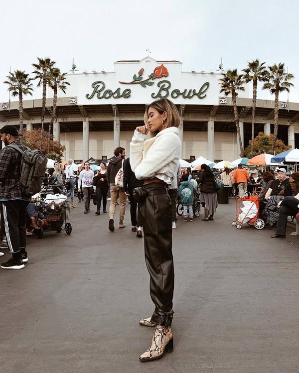 pants leather pants black pants snake print heel boots belt bag white jacket teddy jacket cropped jacket