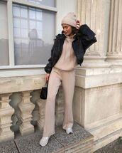 sweater,beige,flare pants,man repeller,sneakers,black jacket,beanie,black bag
