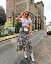 skirt,midi skirt,leopard print,asymmetrical skirt,white boots,ankle boots,white t-shirt,mini bag