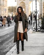 coat,long coat,knee high boots,black boots,green coat,white skirt,mini skirt,black turtleneck top,shoes,heel boots