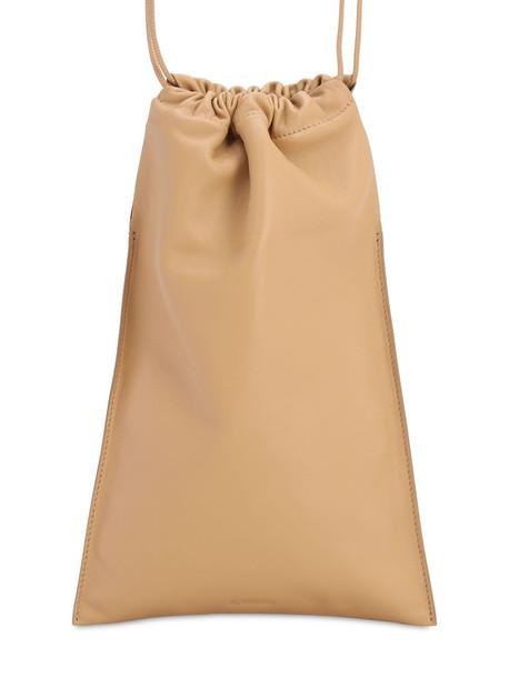 JIL SANDER Xs Flat Drawstring Smooth Leather Bag in sand